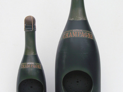 We created the CAD designs and CNC lathing of these decorative bottles made from plastic.