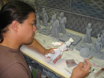 Fon is painting an Usagi Yojimbo statue prototype. The statues were each molded, cast, and created as gray assembled versions. They were then disassembled, painted and reassmbled as painted versions.  https://youtu.be/fxnmeHHEGeQ
