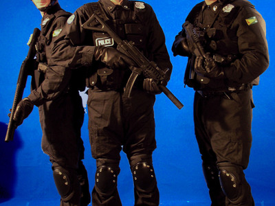 These tactical police costumes with helmets, weapons, and accessories are part of our costume rental library.