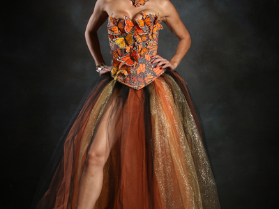This original design was inspired by Effie Trinkett from the Hunger Games for the Her Universe fashion show at San Diego Comic Con, modeled by Adrianne Curry of America's Next Top Model.