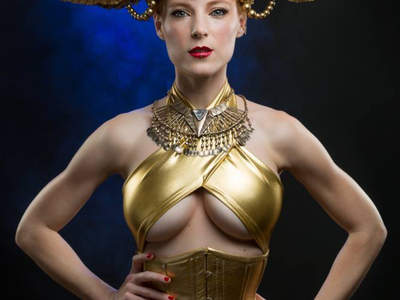 Castle Corsetry created this gold leather corset for Jessica Dru for her fantasy photo shoot with Zack Podratz.