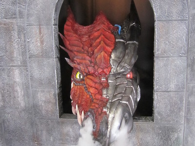 This cyborg dragon with glowing eyes and smoke effects was designed and fabricated for the Sword and Laser show on the Geek and Sundry channel.