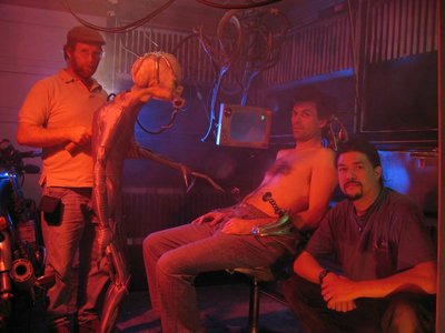 This BTS shot shows creature puppeteer, Danny Wagner, on the set of the award winning sci-fi short film, The Subject, directed by Fon Davis.