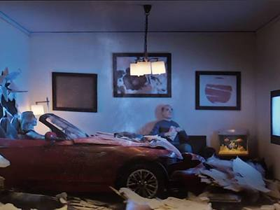 This is a 1/12 scale miniature living room car wreck scene we created with the TV lighting effect for Farmers Insurance for their Hall of Claims ad campaigns.