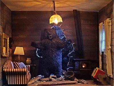 This is a 1/12 scale miniature bear ravaging a log cabin that we created with the TV lighting effect for Farmers Insurance for their Hall of Claims ad campaigns.