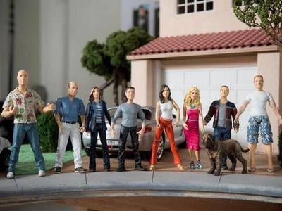 We created these 1/12th scale custom action figures for each member of the cast in Cougar Town plus their houses.