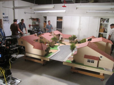 This behind the scenes shot showcases the 1/12th dollhouse scale custom houses and cul de sac miniatures we created for the TV show Cougar Town.
