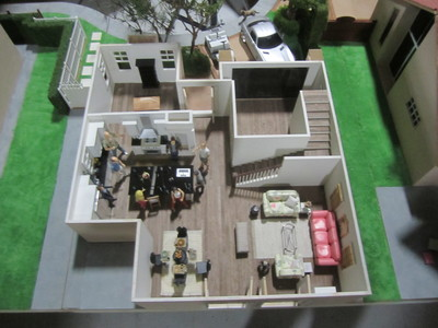This 1/12th dollhouse scale house interior miniature is fully detailed with dressing and loads of wine for Cougar Town.