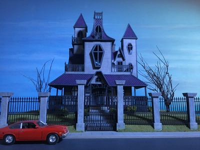 This 1/24th scale haunted house miniature shooting model was created for LeeAnna Vamp and her Best Fiends Forever show.