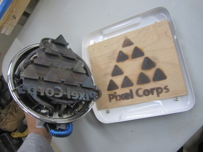 This is a custom made, water jet cut, electric branding iron for Pixel Corps to mark their gear with.