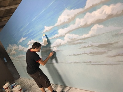 This is one of our many painted sky backdrops avail be for rent in the process of being painted by one of our talented artists.
